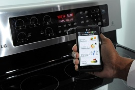 LAS VEGAS, NV – JANUARY 11:  A smartphone sending instructions to an oven using LG's newest Smart ThinQ technology is demonstrated at the LG Electronics booth at the 2012 International Consumer Electronics Show at the Las Vegas Convention Center January 11, 2012 in Las Vegas, Nevada. LG's line of smart home appliances coming out in 2012, have improved connectivity between them and other devices like phones and TVs, allowing for easier control and monitoring of the devices. CES, the world's largest annual consumer technology trade show, runs through January 13 and features more than 3,100 exhibitors showing off their latest products and services to about 140,000 attendees.