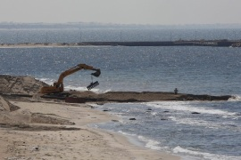 A view of works being done on the Egyptian coastline of the Mediterranean Sea, seen from the Gaza side of the border between Egypt and Gaza, in Rafah, southern Gaza Strip, 19 September 2015. The Egyptian army has begun to pump water from the Mediterranean Sea into underground smuggling tunnels connecting Sinai with the Gaza Strip, security officials and eye witnesses reported on 18 September 2015. Gaza, administered by the Islamic Hamas movement, remains under a tight blockade imposed by Israel and Egypt.