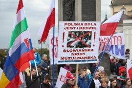 Protesters march with a banner reading 'Poland is, was and will be Slavic, never Muslim', during a demonstration rally against the acceptance of migrants to Poland, in Warsaw, Poland, 26 September 2015. The rally, organized by the Polish Youth, was against the decision to accomodate some 7,000 refugees, imposed by the European Union.  EPA/RAFAL GUZ POLAND OUT