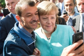 German Chancellor Angela Merkel (R) has a selfie taken with a refugee during a visit to a refugee reception centre in Berlin, Germany, 10 September 2015. Germany can deal with the arrival of hundreds of thousands of refugees without cutting social welfare benefits or raise taxes, Vice Chancellor Sigmar Gabriel said on 10 September, during a debate in parliament on next year's budget. Germany expects 800,000 asylum seekers this year, four times more than last year and more than any other country in the European Union, which is split on how to deal with the biggest refugee crisis since World War II.
