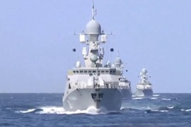 Russian warships are seen sailing in the Caspian Sea in this frame grab taken from footage released by Russia's Defence Ministry October 7, 2015. The Russian defence ministry said on Wednesday that 26 rockets fired by its warships earlier in the day had struck targets associated with Islamic State and Al-Nusra, the Interfax news agency reported. REUTERS/Ministry of Defence of the Russian Federation/Handout via Reuters ATTENTION EDITORS – FOR EDITORIAL USE ONLY. NOT FOR SALE FOR MARKETING OR ADVERTISING CAMPAIGNS. THIS IMAGE HAS BEEN SUPPLIED BY A THIRD PARTY. IT IS DISTRIBUTED, EXACTLY AS RECEIVED BY REUTERS, AS A SERVICE TO CLIENTS. REUTERS IS UNABLE TO INDEPENDENTLY VERIFY THE AUTHENTICITY, CONTENT, LOCATION OR DATE OF THIS IMAGE. FOR EDITORIAL USE ONLY. NO SALES. NO ARCHIVES