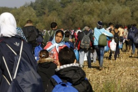 New refugees walk from Croatia to Slovenia through fields escorted by members of the Slovenian army near Rigonce village on the Slovenian border with Croatia, 24 October 2015. Many of the migrants are exhausted, they have been waiting for hours at the closed border in Croatia in the hope of entering Slovenia, the next stage on their long journey to Austria, Germany or Sweden. Europe is grappling with the biggest migrant influx since World War II, and more than half of those arriving are estimated to be from Syria.