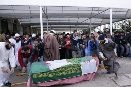 الموسوعة -epa02522580 The funeral of an undentified Algerian youth who died after allegedly being hit by   a tear gas shell while he was out looking for his brother during a protest, takes place in Bou Smail, some 40 km west of the capital Algiers, Algeria, 09 January 2011. Algerian youths took to the street in violent protests against price hikes of some food products since 05 January evening. Media reports said that at least two people died during or on the fringe of the protests and  Algerian Interior Minister Dahou Ould Kablia said, that more than 800 people were injured in the riots, adding that 750 of them were members of the security forces.
