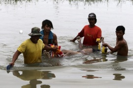 Filipino villagers carry the body of a drowned typhoon victim at the flood hit village of Santa Rosa, Nueva Ecija province, northern Manila, Philippines, 20 October 2015. Philippine emergency teams were attempting to reach victims stranded by flooding from Typhoon Koppu, and began clearing areas damaged by the storm which battered the north of the country. Soldiers, police officers and other emergency workers were dispatched to the northern province of Nueva Ecija, a rice-growing province where murky floodwaters reached up to rooftops in some places.  EPA/FRANCIS R. MALASIG ATTENTION EDITORS: PICTURE CONTAINS GRAPHIC CONTENT