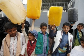 "Boys hold up jerrycans to represent drinking water during a protest against a Saudi blockade of Yemen's ports, outside the United Nations' offices in Sanaa, Yemen October 19, 2015. U.N.-sponsored talks to end months of fighting in Yemen will convene in Geneva at the end of October, the U.N. special envoy for the issue has announced, urging the parties to try to make the negotiations a success. At least 5,400 people have been killed in the six-month civil war in the poorest country on the Arabian Peninsula, and the United Nations says the humanitarian situation, exacerbated by a Saudi blockade of Yemen's ports, is ""critical"". REUTERS/Khaled Abdullah"