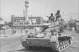 "(FILES) An Israeli tank patrols near a mosque in this photo taken in June 1967. Thirty years after the six-day war, new revelations show that Israeli generals exerted considerable pressure to push their government to go into battle. According to military historian Ami Gluska of the Hebrew University in Jerusalem, ""a gap separated government officials from soldiers who were on average more than 20 years younger and who were burning to go to war"". Eds note: Photo available only in black and white."