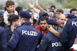 Police maintain order as migrants attempt to leave the border crossing in Nickelsdorf, Austria September 14, 2015. Austria announced on Monday it would dispatch the armed forces to guard its eastern frontier, following Germany's lead in reimposing Europe's internal border controls after thousands of migrants streamed across its frontier from Hungary on foot. REUTERS/Leonhard Foeger