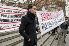"People hold banners during a demonstration of members of Muslim community and groups fighting discrimination against Muslims after the Paris attacks, in Poznan, Poland November 29, 2015. Banner on right reads ""Racism and ISIS – the same thinking, other methods""   REUTERS/Lukasz Cynalewski/Agencja Gazeta     ATTENTION EDITORS – THIS PICTURE WAS PROVIDED BY A THIRD PARTY. THIS PICTURE IS DISTRIBUTED EXACTLY AS RECEIVED BY REUTERS, AS A SERVICE TO CLIENTS. POLAND OUT. NO COMMERCIAL OR EDITORIAL SALES IN POLAND."