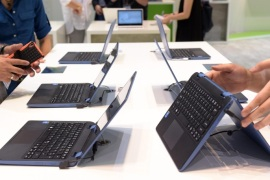 Visitors look at Acer laptops at the trade fair stand of Acer to the International Consumer Electronics Fair IFA in Berlin, Germany, 02 September 2015. The fair will take place from 4 to 9 September 2015.