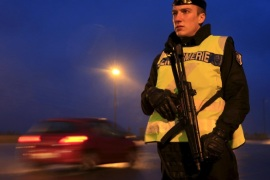 An armed French gendarme stands along the highway as gendarmes check vehicles and verify the identity of travellers on the A2 motorway between Paris-Brussels at the Thun-L'eveque toll station, in France, November 19, 2015, as security increases after last Friday's deadly attacks in the French capital. REUTERS/Pascal Rossignol