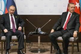 FILE – In this file photo taken on Monday, Nov.  16, 2015, Russian President Vladimir Putin, left, and Turkish President Recep Tayyip Erdogan pose for the media before their talks during the G-20 Summit in Antalya, Turkey.  Putin ordered the deployment of long-range air defense missiles to a Russian military base in Syria and Russia's military said it would destroy any target that may threaten its warplanes following the downing of a Russian military jet by Turkey. (AP Photo/Alexander Zemlianichenko, file)