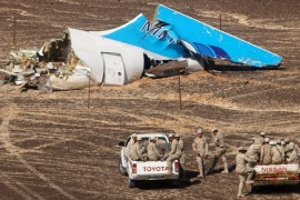 FILE – In this file photo made available Monday, Nov. 2, 2015, and provided by Russian Emergency Situations Ministry, Egyptian Military on cars approach a plane's tail at the wreckage of a passenger jet bound for St. Petersburg in Russia that crashed in Hassana, Egypt, on Sunday, Nov. 1, 2015. After the Islamic State group claimed the downing of the Russian plane in Egypt and deadly suicide bombings in Lebanon and Turkey, the Paris attacks appear to signal a fundamental shift in strategy toward a more global approach that experts suggest is likely to intensify. (Maxim Grigoriev/Russian Ministry for Emergency Situations via AP, FILE)