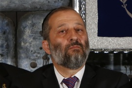 file picture taken on May 19, 2015, shows Israeli Minister of Economy Aryeh Deri looking on during the traditional photograph in honor of the swearing in of the 34th government of Israel at the Presidential compound in Jerusalem. Deri resigned on November 1, opening the way for the government to greenlight a multibillion dollar gas deal with US energy giant Noble Energy, a statement from the Prime Minister's office said. AFP PHOTO/GALI TIBBON
