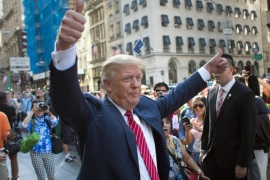 "FILE – In this Sept. 24, 2015, file photo, Republican presidential candidate Donald Trump waves to the crowd gathered in front of Trump Tower ahead of the arrival of the pope's motorcade for an appearance in New York's Central Park. Trump holds a trademark to use the words ""Central Park"" on items including furniture, chandeliers and even key chains. Records show his first application came in 1991, when the city's crime rate was near its height and the park had a less-than-glamorous reputation. (AP Photo/Kevin Hagen, File)"