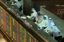 Traders sit at Kuwait Stock Exchange, Kuwait City, Kuwait, 24 August 2015. Shares, commodities and currencies have all suffered losses over rising fears over CHina's economy and the country's Government's ability to handle the crisis.