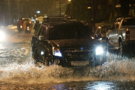 A vehicle drives down a flooded street as heavy rain pours in Makati city, south of Manila, Philippines, 15 December 2015. At least four people were killed and hundreds of thousands displaced as a powerful typhoon pummelled the Philippines for the second day, officials said. Typhoon Melor also toppled trees and electric posts, totally and partially destroyed houses, as well as submerging rice paddies in waters, according to the National Disaster Risk Reduction and Management Council (NDRRMC). Thousands of air and sea passengers were stranded in different ports and airports as 64 domestic flights were cancelled while hundreds of ships were stopped from sailing due to bad weather.