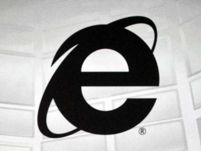 This June 4, 2012 photo shows the Microsoft Internet Explorer logo projected on a screen during the Microsoft Xbox E3 media briefing in Los Angeles. After 20 years of competing against rival web browsers, Microsoft is close to launching its own alternative to its once-dominant Internet surfing program. (AP Photo/Damian Dovarganes)