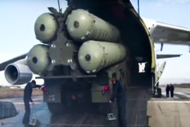 This photo made from the footage taken from Russian Defense Ministry official web site on Friday, Nov. 27, 2015, shows a Russian S-400 air defense missile systems being unloaded from an An-124 Ruslan cargo plane at the Hemeimeem air base in Syria, about 50 kilometers (30 miles) south of the border with Turkey. Russia's President Vladimir Putin has ordered the deployment of the S-400s to the Russian base in Syria to help protect Russian warplanes after Turkey downed a Russian military jet at the border with Syria on Tuesday. (Russian Defense Ministry Press Service pool photo via AP)