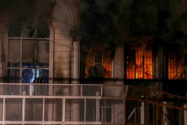 AK115 – Tehran, -, IRAN :  Iranian protesters set fire to the Saudi Embassy in Tehran during a demonstration against the execution of prominent Shiite Muslim cleric Nimr al-Nimr by Saudi authorities, on January 2, 2016. Nimr was a driving force of the protests that broke out in 2011 in Saudi Arabia's east, an oil-rich region where the Shiite minority of an estimated two million people complains of marginalisation. AFP PHOTO / ISNA / MOHAMMADREZA NADIMI
