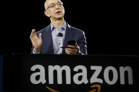 Amazon CEO Jeff Bezos demonstrates the new Amazon Fire Phone, Wednesday, June 18, 2014, in Seattle. (AP Photo/Ted S. Warren)