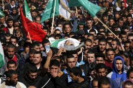 Palestinians carry the body of 23 years old Mohammad Kawazbeh during his funeral in the West Bank village of Sae'er, 13 January 2016. Kawazbeh was shot dead at a checkpoint near Hebron after he tried to stab an Israeli soldier on 12 January.