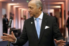 French Foreign Minister Laurent Fabius, President-designate of COP21, reacts after a press conference during the World Climate Change Conference 2015 (COP21) at Le Bourget, near Paris, France, December 11, 2015. Fabius said on Friday he was confident a global accord to combat climate change could be adopted after a final draft will be released on Saturday morning. REUTERS/Stephane Mahe
