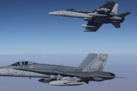 A handout image released by the Royal Australian Air Force (RAAF) on 12 September 2015 shows two F/A-18A Hornets from Australia's Air Task Group fly in formation with a Royal Australian Air Force KC-30A Multi Role Tanker Transport aircraft during the first missions of Operation OKRA over Syria, 11 September 2015. The Australian Defense Force Operation OKRA started in August 2014 with the aim to combat IS in Iraq and the Levant.  EPA/RAAF / SGT Pete