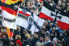 Supporters of anti-immigration right-wing movement PEGIDA (Patriotic Europeans Against the Islamisation of the West) carry various versions of the Imperial War Flag (Reichskriegsflagge) during a demonstration march, in reaction to mass assaults on women on New Year's Eve, in Cologne, Germany January 9, 2016. Picture taken January 9, 2016.     REUTERS/Wolfgang Rattay