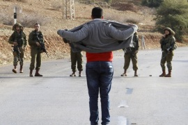 A Palestinian man removes his clothes after being asked to do so by Israeli soldiers as he tries to reach the body of his brother, killed after after two Palestinians reportedly tried to stab soliders, at Al-Hamra checkpoint in the Jordan Valley, 09 January 2016. Two Palestinians are dead after Israeli soldiers opened fire upon them near an army checkpoint in the West Bank, said the Israeli army. The army said the two Palestinians approached a checkpoint in the Jordan Valley and attempted to stab soldiers.