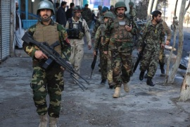 Afghan soldiers arrive at the scene of a suicide bomb attack near the Pakistani consulate in Jalalabad, Afghanistan, 13 January 2016. At least four persons were killed as fighting continued between Afghan forces and Taliban militants who launched attacks at the Pakistani consulate in Jalalabad.
