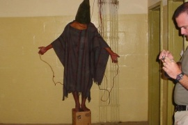 FILE – This late 2003 file photo, an image obtained by The Associated Press, shows an unidentified detainee standing on a box with a bag on his head and wires attached to him in the Abu Ghraib prison in Baghdad, Iraq. Amid violence like the attack in Paris on a satirical newspaper over its depictions of the Prophet Muhammad, there's been increasing discussions among Muslims who say their community must re-examine their faith to modernize its interpretations and sideline extremists. Cherif Kouachi, one of the French brothers behind the Charlie Hebdo killings, appears to have been first radicalized by hearing of abuses of Iraqi inmates by American guards at Abu Ghraib prison. (AP Photo, File)