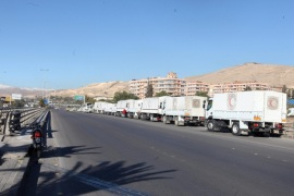 Trucks with relief goods stand in front of the United Nations Relief and Works Agency (UNRWA) offices in Damascus, Syria, 17 February 2016. Around 73 trucks loaded with food, infant formula and medicines, in addition to a mobile clinic and a medical team, will head to the besieged rebel-held towns of Madaya, al-Zabadani and al-Moadhamiya, as part of a UN sponsored aid operation in the war-torn country. A similar convoy of 25 trucks, a mobile clinic and a medical team, headed to the villages of Foua and Kfraya in the northern Idlib, which are besieged by rebels. The convoys are the third humanitarian aid delivery to the besieged areas after two similar efforts last month.