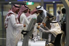 Jobseekers stand in line to talk with a recruiter at a booth at a job fair in Riyadh in this January 29, 2012 file photo. After Saudi Arabia passed a long-awaited law covering housing mortgages in early July, banking shares rocketed over 5 percent in a single day as investors bet the reform would unlock a lucrative source of revenue for banks. After global oil prices slid below $10 a barrel in 1998, Saudi Arabia launched a programme of reforms designed to diversify the economy away from its heavy reliance on oil, strengthen the private sector and create jobs for young Saudis. To match Analysis SAUDI-ECONOMY/REFORM   REUTERS/Fahad Shadeed/Files (SAUDI ARABIA – Tags: BUSINESS REAL ESTATE EMPLOYMENT POLITICS)