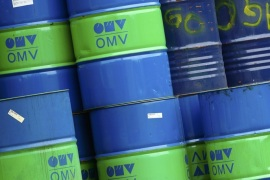 Barrels are pictured at the refinery of Austrian oil and gas group OMV in Schwechat, Austria, October 21, 2015. Oil majors are expected to post the worst set of earnings since the onset of the sector's downturn, with writedowns likely to dominate headlines as companies respond to a further drop in the price of crude in the third quarter. Between October 26 and November 12 the world's top listed oil and gas producers will reveal just how badly they've been hurt by the 17 percent quarter-on-quarter fall in prices. REUTERS/Heinz-Peter Bader
