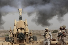 FILE – In this April 20, 2015 file photo, Saudi soldiers fire artillery toward three armed vehicles approaching the Saudi border with Yemen in Jazan, Saudi Arabia. Saudi Arabia's offer to put boots on the ground to fight Islamic State in Syria is as much about the kingdom's growing determination to flex its military might as it is about answering U.S. calls for more help from Mideast allies. (AP Photo/Hasan Jamali, File)