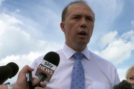 Australia's Immigration Minister Peter Dutton (C) speaks to members of the media at East Arm Wharf in Darwin, Australia, 17 December 2015. Dutton was in the Northern Territory to announce that Australian Border Force will be permanently berthed at the Darwin Port in order to continue anti-people smuggler and narcotics trafficking operations.  EPA/NEDA VANOVAC AUSTRALIA AND NEW ZEALAND OUT