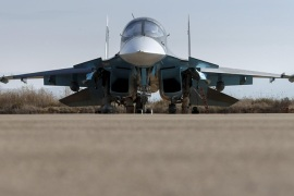 Russian ground staff members work on a Sukhoi Su-34 fighter jet at the Hmeymim air base near Latakia, Syria, in this handout photograph released by Russia's Defence Ministry October 22, 2015. REUTERS/Ministry of Defence of the Russian Federation/Handout via Reuters ATTENTION EDITORS – THIS PICTURE WAS PROVIDED BY A THIRD PARTY. REUTERS IS UNABLE TO INDEPENDENTLY VERIFY THE AUTHENTICITY, CONTENT, LOCATION OR DATE OF THIS IMAGE. EDITORIAL USE ONLY. NOT FOR SALE FOR MARKETING OR ADVERTISING CAMPAIGNS. NO RESALES. NO ARCHIVE. THIS PICTURE IS DISTRIBUTED EXACTLY AS RECEIVED BY REUTERS, AS A SERVICE TO CLIENTS