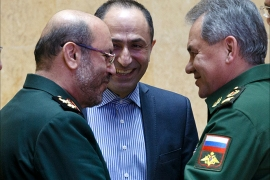 epa05164943 Russian Defense Minister Sergei Shoigu (R) and Iranian Defense Minister Hossein Dehghan (L) shake hands during their meeting in Moscow, Russia, 16 February 2016. The Iranian defense minister visits Moscow for talks about closer military cooperation.  EPA