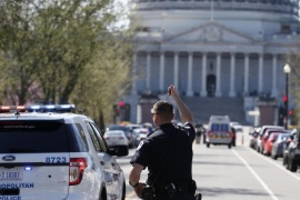 Law enforcement and rescue vehicle are seen on a street leading to Capitol Hill in Washington, Monday, March 28, 2016, after reports of gunfire at the Capitol Visitor Center complex. (AP Photo/Alex Brandon)