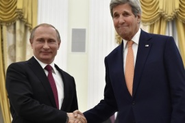 U.S. Secretary of State John Kerry, right, shakes hands with Russian President Vladimir Putin at the Kremlin in Moscow, Russia, Thursday, March 24, 2016.  Kerry on Thursday voiced hope that Washington and Moscow could narrow their differences on Syria and Ukraine as he sat down for talks with Russian President Vladimir Putin.(Alexander Nemenov/Pool Photo via AP)
