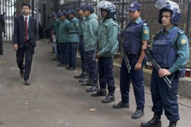 Bangladeshi policemen stand guard outside a special court during the trial of people allegedly involved in killing, kidnapping and looting during the country's independence war against Pakistan in 1971, in Dhaka, Bangladesh, Tuesday, Feb. 2, 2016. Twenty-five people have been convicted since a special tribunal was set up by the government in 2010. (AP Photo)