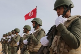 (FILE) A file photo dated 06 February 2016 shows Tunisian soldiers posing during a presentation of the anti-jihadi fence close to the border with Libya, near Ben Guerdane, eastern Tunisia. According to a joint statement by the Interior and Defence ministries in Tunisia on 07 March 2016, at least 26 were dead after clashes between Tunisian security forces and unidentified insurgents near the border with Libya. Six terrorist suspects were arrested and 21 killed during the clashes, which erupted in the Tunisian border town of Ben Gardane, the statement added.