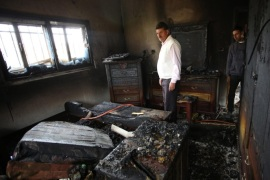 Palestinian men inspect the damage at the burned house of Ibrahim Dawabsha, from the West Bank village of Duma, 20 March 2016. Ibrahim Dawabsha is a key witness in the firebombing attack carried out by Jewish extremists on July 2015 against Dawabsha family that killed an 18-month-old boy with his two parents. Palestinian media report that according to Duma residents; the window of the family bedroom was broken and a Molotov cocktails were thrown inside, raising suspicions of a second arson attack in the village. Ibrahim Dawabsha was not hurt in the fire incident.