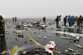 Firefighters search for the flight recorders among aircraft debris scattered on the runway after the crash of a Boeing 737-800 of FlyDubai, at Rostov-on-Don airport, Russia, 19 March 2016. The FlyDubai plane that crashed in Rostov-on-Don airport in southern Russia has left 62 people dead, according to the Russian Ministry of Emergency Situations. The plane, which completed its first commercial flight in December 2010, suffered the fatal crash during its second attempt to land amid poor visibility caused by heavy fog, incessant rain and strong winds, conditions described by experts as stormy.