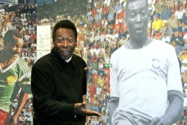 epa000314102 Brazilian soccer legend Pele poses next to a photography of himself in action during the opening of the exhibition '100 Years of Planet Football' at the Olympic Museum in Lausanne, Switzerland, Wednesday 17 November 2004. The year 2004 marks the centenary celebration of the International Association Football Federation (FIFA). The exhibiton presents a historical, social and cultural view of football by retracing the highlights of the World Cup, enabling the visitor to discover the history of FIFA and its many involvements in the development of football worldwide. EPA/MARTIAL TREZZINI