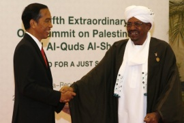 Indonesian President Joko Widodo (L) greets Sudan's President Omar Hassan Ahmad al-Bashir during the 5th Extraordinary Organization of Islamic Cooperation (OIC) Summit on Palestinian issues in Jakarta, Indonesia, 07 March 2016. Indonesian President Joko Widodo urged Israel to end the occupation of Palestinian territories, saying international patience 'has long run out,' at the opening of the summit. The summit, organized at the request of the Palestinian Authority, planned to discuss the deteriorating situation in Palestinian territories and reaffirm the grouping's support for Palestinian independence.