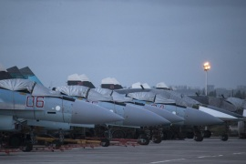 Russian fighter jets and bombers are parked at Hemeimeem air base in Syria, Friday, March 4, 2016. Russian warplanes have mostly stayed on the ground since the Russian- and U.S.-brokered cease-fire has begun last weekend. (AP Photo/Pavel Golovkin)