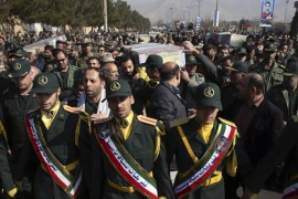 Civilians and armed forces members carry the flag draped coffins of Iranian Revolutionary Guard Gen. Mohsen Ghajarian and five soldiers who were killed in fighting in Syria, during their funeral ceremony outside the headquarters of the guard's ground forces, in Tehran, Iran, Saturday, Feb. 6, 2016.  Iran has held a joint funeral for six soldiers who were killed while fighting alongside President Bashar Assad's forces in northern Syria while battling the Islamic State group and Syrian rebels. (AP Photo/Vahid Salemi)