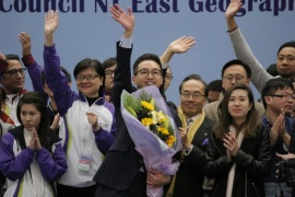 Pro-democracy candidate Alvin Yeung, center with flower, and supporters wave after Yeung won the by-election in Hong Kong Monday, Feb. 29, 2016. Yeung, representing a mainstream pro-democracy party, is running in a by-election for a Hong Kong Legislative Council seat in a contest that serves as a prelude for citywide elections later this year pitting pro-democracy parties against pro-Beijing groups. Yeung of the mainstream Civic Party won the Legislative Council seat with 37 percent of the vote, edging out a pro-Beijing candidate. (AP Photo/Vincent Yu)