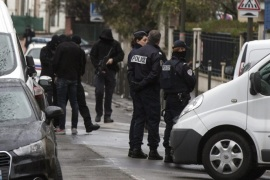 Police officers and investigators stand outside a building where an anti-terrorism operation took place in Argenteuil, near Paris, 25 March 2016. A terrorist attack had been thwarted in Paris with the arrest of a suspected terrorist whose plans for an attack were in an advanced state. A suspect terrorist named Reda Kriket has been arrested in Boulogne Billancourt.and Parisians lay and Belgian flags, flowers, candles, personalised messages for victims of terror attacks in Brussels in front of the monument on Place de la Republique, Paris, France, 23 March 2016. At least 31 people have been killed with hundreds injured in terror attacks in Brussels, Belgium on 22 March, which Islamic State (IS) has claimed responsibility for the attacks.  EPA/IAN LANGSDON  EPA/ETIENNE LAURENT
